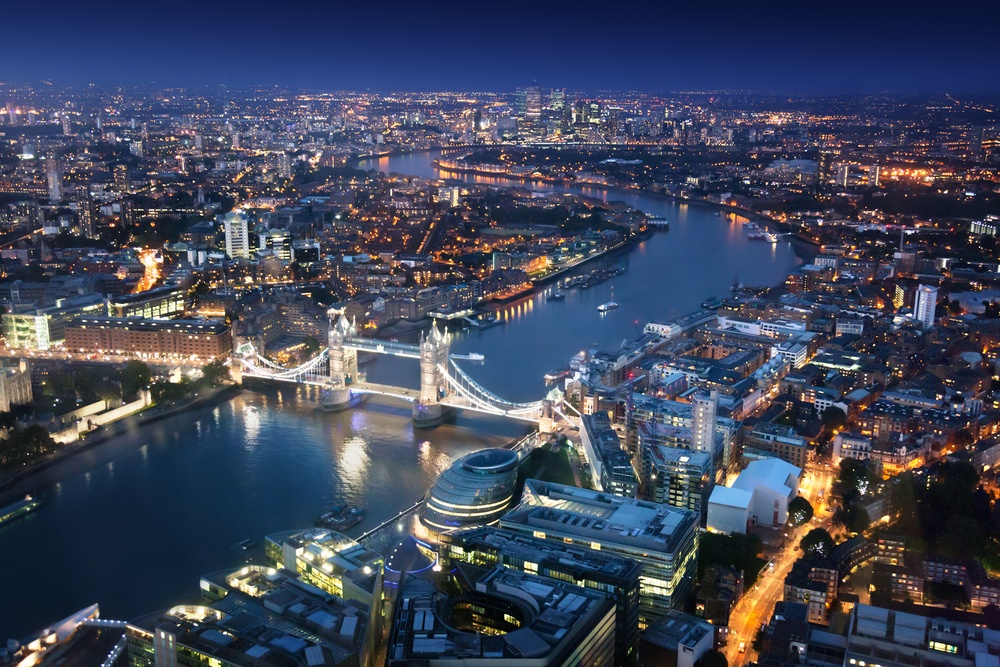 London at night with urban architectures and Tower Bridge.jpeg
